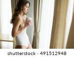 woman in her underwear holding... | Shutterstock . vector #491512948