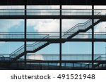 Small photo of modern urban structure, an aerial ladder metal / staircase between floors in a modern building