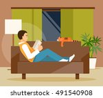 young man lying on the couch... | Shutterstock .eps vector #491540908