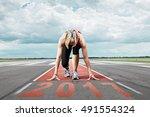 Female Runner Waits For The...