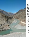 Small photo of Confluence of river Indus and Zanskar amidst the mountain ranges