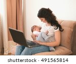 Beautiful Young Mother Working...