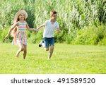 cheerful little girl and boy... | Shutterstock . vector #491589520