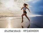 active sporty woman run along... | Shutterstock . vector #491604004