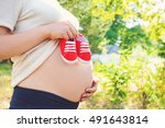 Pregnant Woman Outside Holding...