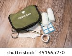 Green First Aid Kit On Wooden...