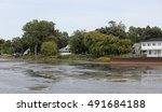 cabins and trees on a bay | Shutterstock . vector #491684188