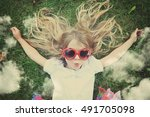 a happy child is laying down on ... | Shutterstock . vector #491705098