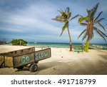 Small photo of Wood Cart with Go Slow message at Caye Caulker - Belize