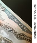 Small photo of Afghan afghani, Afghanistan bank note paper money, close up