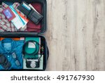 open traveler's bag with... | Shutterstock . vector #491767930