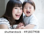 mother with her baby | Shutterstock . vector #491837908