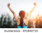 successful man raising arms... | Shutterstock . vector #491840710