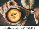autumn creamy pumpkin soup with ... | Shutterstock . vector #491854399