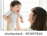 mother with her baby | Shutterstock . vector #491857810