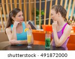 Two Sporty Young Women Talking...