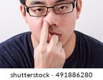 young asian man picking nose | Shutterstock . vector #491886280