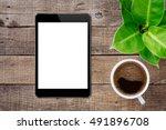 digital tablet on wood table...   Shutterstock . vector #491896708