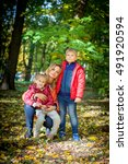 mother with kids in the autumn... | Shutterstock . vector #491920594