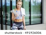 female jogger with water bottle ... | Shutterstock . vector #491926006