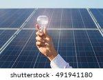 Man Holding Bulb Whit Solar...