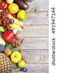 ripe fruits and vegetables on... | Shutterstock . vector #491947144