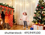 small child in santa hat at... | Shutterstock . vector #491949100