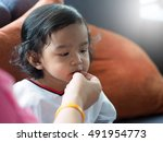 mother feeding snack to asian... | Shutterstock . vector #491954773