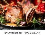 christmas sliced roasted ham on ... | Shutterstock . vector #491968144