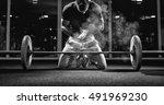 muscular weightlifter clapping... | Shutterstock . vector #491969230