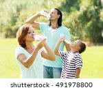parents with son drinking from...   Shutterstock . vector #491978800