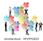 team of businesspeople build a... | Shutterstock . vector #491991823