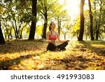 woman yoga relaxing in nature | Shutterstock . vector #491993083
