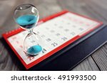 hour glass on calendar concept... | Shutterstock . vector #491993500