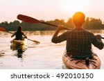 meeting sunset on kayaks. rear... | Shutterstock . vector #492010150