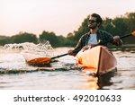 enjoying life on river.... | Shutterstock . vector #492010633
