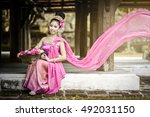 Young Thai Woman With...
