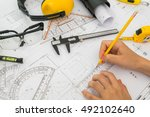 hand over construction plans... | Shutterstock . vector #492102640