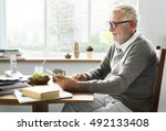 senior adult holding tablet... | Shutterstock . vector #492133408
