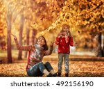 Happy Family On Autumn Walk ...