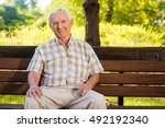 Old Man Sits On Bench. Elderly...