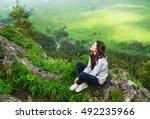 beautiful woman sitting on...   Shutterstock . vector #492235966