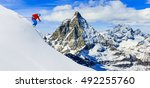 skier skiing downhill in high... | Shutterstock . vector #492255760