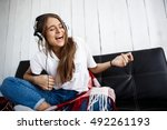 Girl In Plaid Listening Music...