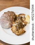 Small photo of grilled Japanese Abalone steak with lemon