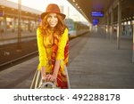 pretty young woman at a train... | Shutterstock . vector #492288178