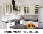 Stock photo stylish kitchen with white furniture backsplash and solid worktop 492288286