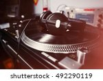 headphones laying on turntable... | Shutterstock . vector #492290119