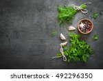 herbs and spices at dark slate... | Shutterstock . vector #492296350