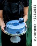 hands of chef holding trendy... | Shutterstock . vector #492310858